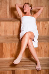 Woman enjoying a hot sauna
