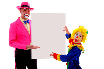 Two clowns holding empty text board