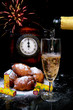 traditional New Year's eve food and clock on midnight