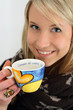 blonde girl whit a cup of tea