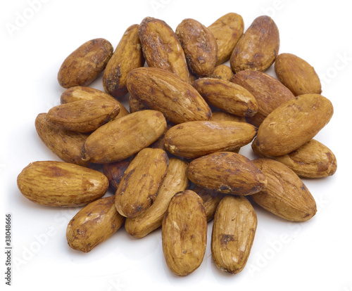 Raw cacao beans isolated on white background.