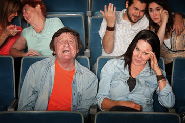 Man Weeps In Theater