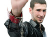 Young caucasian man hand with red handcuff. Guy out of focus