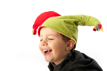 Child laughing with minstrel mask isolated on white background.