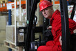 forklift driver worker in red uniform and safety helmet