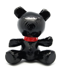 Black latex toy bear isolated on white background