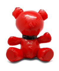 Red latex toy bear isolated on white background