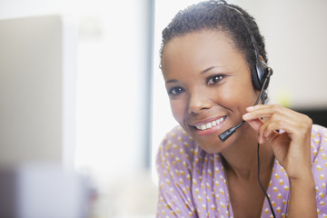 Close up portrait of smiling businesswoman with headset