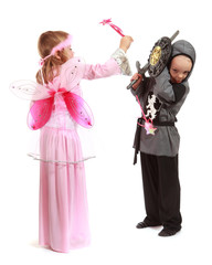 Young girl as magic fairy and boy dressed as a Knight isolated