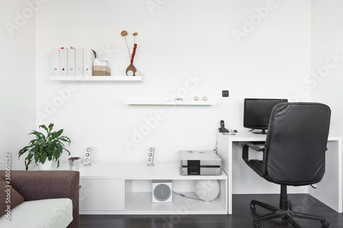 Modern living room with computer desk and the screen