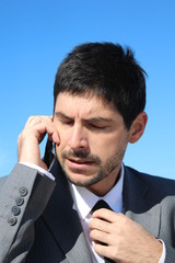 Businessman is speaking on his smartphone, worried