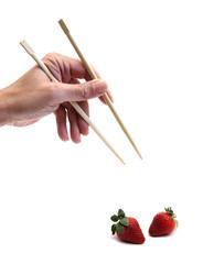 chopsticks and strawberry