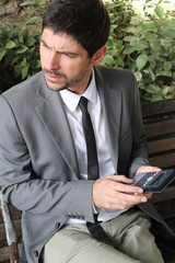 Businessman and his calculator, outside