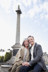 Portrait of smiling couple under London monument