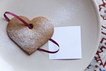 Holiday cookie heart with paper note