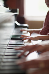 Close up of hands on piano