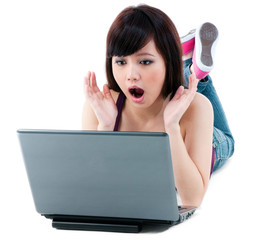 Young Woman Looking Surprised At Laptop