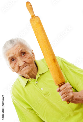 angry old woman threatening with a rolling pin