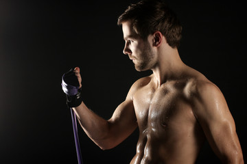 A young athlete trains his muscles