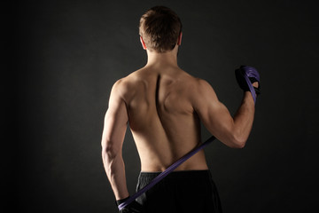 A young athlete trains his back muscles