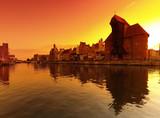 Fototapeta Sunset cityscape with vibrant colors. Gdansk, Poland.