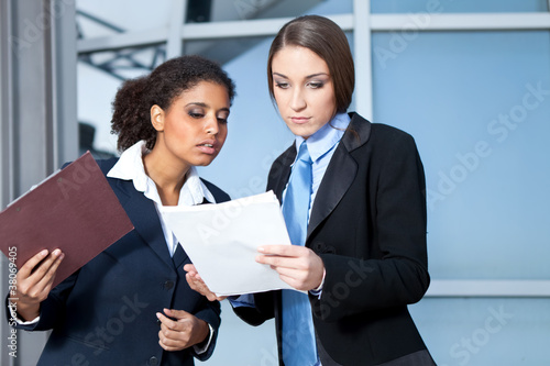 coworkers  looking in paperwork