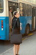 young business woman hurry on public transport