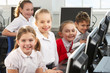 Children using computers in school class