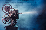 Fototapety old film projector with dramatic lighting
