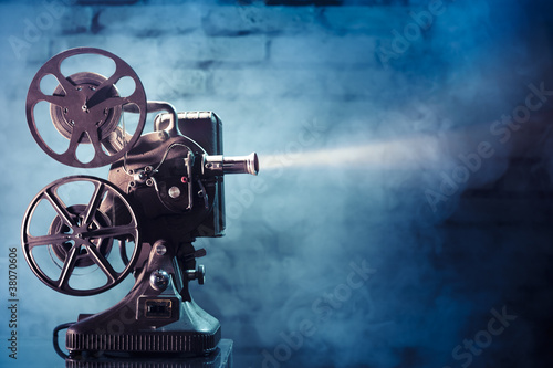 canvas print picture old film projector with dramatic lighting