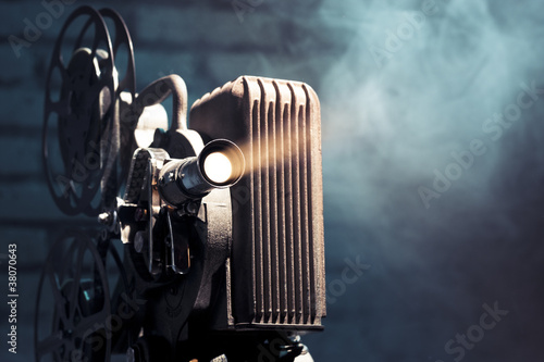 old film projector with dramatic lighting - 38070643