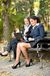 businesswomen on break in park