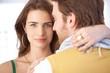 Pretty woman embracing man smiling