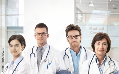 Team of doctors in hospital lobby