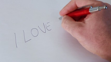 """Writing """"i love you"""" on a white foil"""