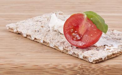 Crispbread,cherry tomato and basil