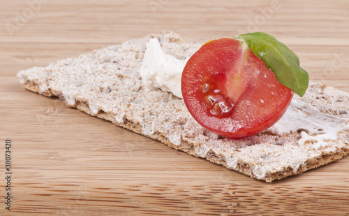 Crispbread,cherry tomato and basil
