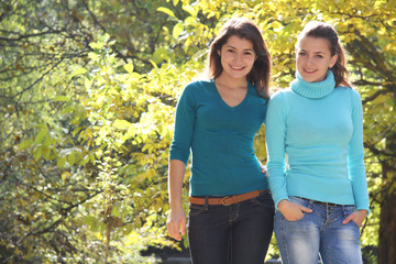 two young happy women on natural background