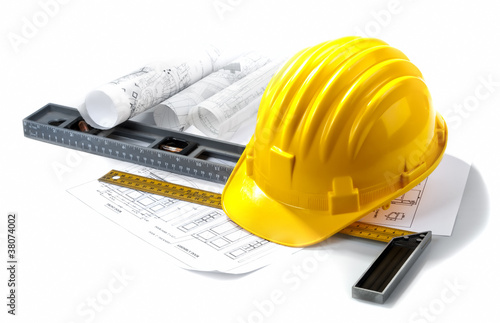 isolated hard hat with blueprints and rulers on white - 38074002
