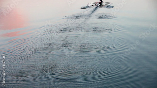rowing at dusk - leaving wonderful waving pattern