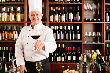Chef cook smiling serve wine glass restaurant
