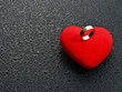 Ring on red heart