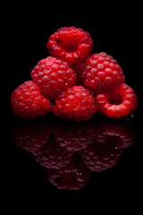 Raspberry closeup. Isolated on black.