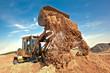 Wheel loader machine unloading soil at construction site