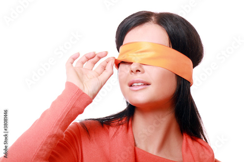 Woman with orange ribbon on her face