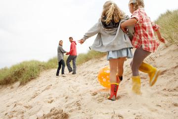 Family having fun on beach vacation