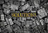 Solutions spelled out in metal letters