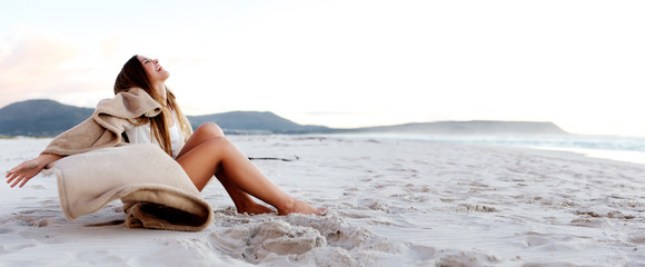 Beautiful young woman relaxes on the beach