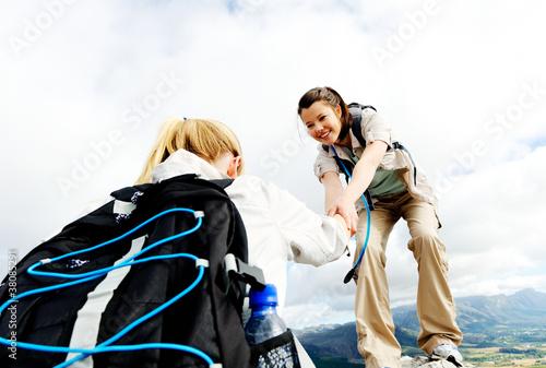 Healthy young women climbing outdoors