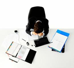 Overwhelmed worker at his desk